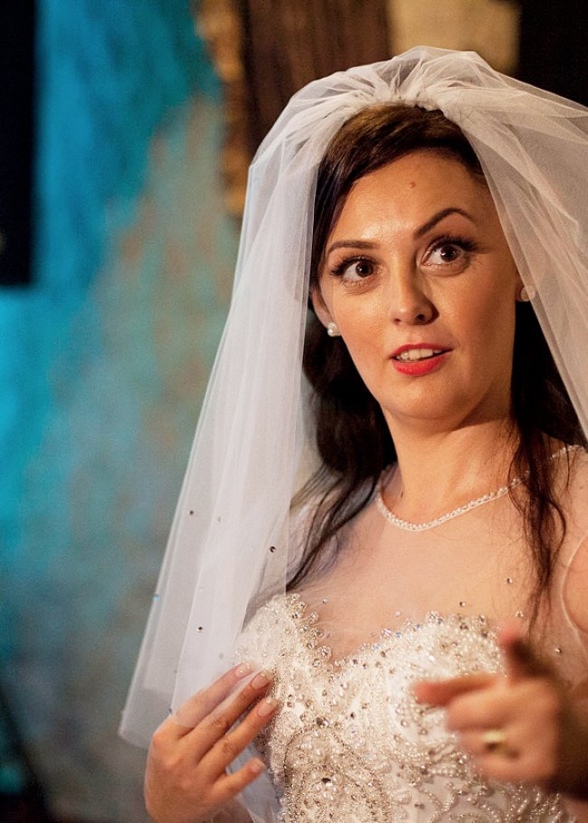 A bride enjoying herself at Hanul Drumetului. As Ion Dumitrescu explains, the wedding industry is the backbone of the manele world.