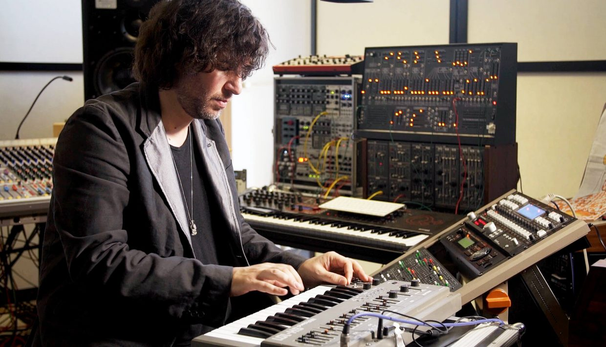 Mathew Jonson in his studio Roland SH-101 synthesizers music gear